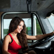 Young attractive girl drive big truck — Stock Photo