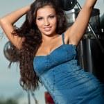 Young pretty girl portrait near steel truck — Stock Photo #7907465