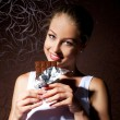 Pretty young girl eating chocolate — Stock Photo