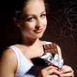 Pretty young girl eating chocolate — Stock Photo #6817256