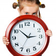 Little girl with clock — Stock Photo #6817272