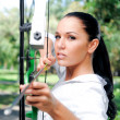 Young woman with a bow and arrows — Stock Photo #6818012