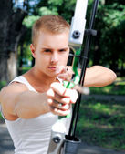 Young man with a bow — Stock Photo
