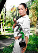 Young woman with a bow and arrows — Stock Photo