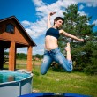 Girl jumps on a trampoline — Stock Photo #7098674