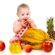 Small child with vegetables and fruits — Stock Photo