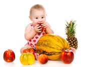 Small child with vegetables and fruits — Foto de Stock