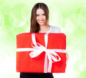 Cute young girl with a gift — Stock Photo