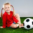 Girl with soccer ball in boots - Stock Photo