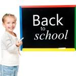 Little girl standing near blackboard — Stock Photo
