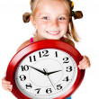 Girl with clock in hands — Stock Photo #7658995