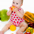 Little child with vegetables and fruits — Stock Photo