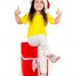 Girl with gifts in santa hat — Stock Photo #7659142