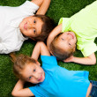 Kids on grass — Stock Photo #7659410