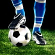 Soccer ball with feet — Stock Photo