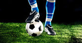 Soccer ball with feet — Stock fotografie