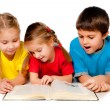 Small kids with a book — Stock Photo