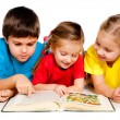 Small kids with a book — Stockfoto