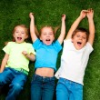 Kids on grass — Stock Photo #7729610