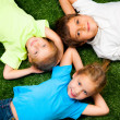 Stock Photo: Kids on grass