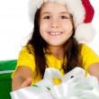 Girl with gifts in santa hat — Stock Photo