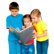 Small kids with a book — Stock Photo #7757479