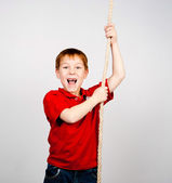 Junge mit einem seil — Stockfoto