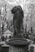Broken tombstone statue. — Stock Photo