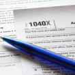 Blue pen and U.S. Income tax form — Stock Photo