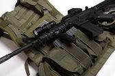 Military concept. Tactical vest and assault rifle. — Stock Photo