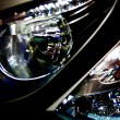 Stock Photo: Electric headlamp and turn signal of motorcycle