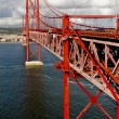 The 25 De Abril Bridge in Lisbon - Stock Photo