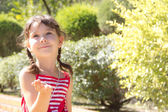 Little girl sends an air kiss and smiling — Stock Photo