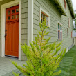 Front orange door of the green house . — Stock Photo #7590083