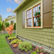 Stock Photo: Newly renovated green house with orange wondows
