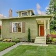 Постер, плакат: Green small craftsman style renovated house