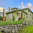 Craftsman green cute house exterior front. - Foto de Stock