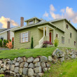 Craftsman green cute house exterior front. - Stock Photo