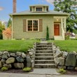 Stock Photo: Craftsmgreen cute house exterior front.