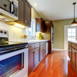 Modern new brown kitchen with cherry floor. — Stock Photo #7590173