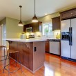 图库照片: Modern new brown kitchen with cherry floor.