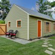 Small green and orange guest house in the back yard — Stock Photo #7590201