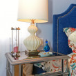 Foto Stock: Nightstand with elegant modern lamp and blue wall