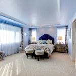 Blue large luxury bedroom with three windows — Stock Photo