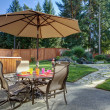 Backyard with table and unbrella - Stock Photo