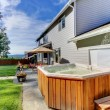 Back yard with house and lrage tub — Stock Photo