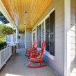 Front porch with rocking chairs and cover - Stock fotografie