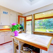 图库照片: Nice white kitchen with door to garden
