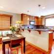 Dining room and kitchen with golden colors — 图库照片 #7596862