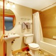 Warm golden bathroom with natural tiles — Stock Photo
